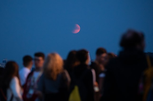 A partial eclipse celebrates the 50th anniversary of the moon landing: photos